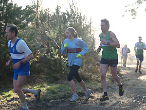 Sarah Edson of Fanham Runners in a group of runners in the Bourne Woods during the 2005 TRXCL race at Farnham