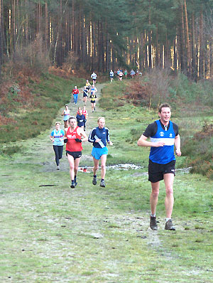 Competitors running through Bourne Woods at the 2006 TRXCL race in Farnham