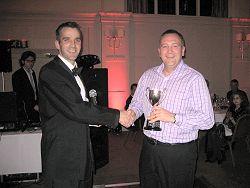 Dan Smith presenting Richard Sheppard with the 2009 Club Handicap trophy