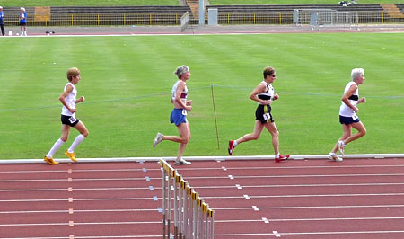 Jane Georghiou (second from left) running on the track at Oxford in the 2009 BMAF 5000m championship