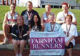 Some of the Farnham Runners with their medals after the 2009 London Marathon