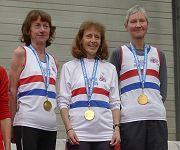 GB team on podium with their gold medals for the 2011 European Veterans Cross Country Championship, Jane Georghiou far right