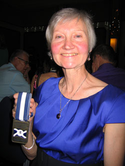 Jane Georghiou holding her team gold medal from the 2011 British and Irish Masters International Cross-Country