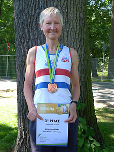 Jane Georghiou with her 10000m bronze medal and certificate at the 2012 European Veterans' Track and Field Championships
