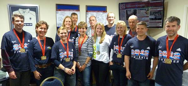 Some of the Farnham Runners team at the club house with their 2012 London Marathon medals and finisher T-shirts