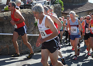 Jane Georghiou running up from promendate at start of one of the Isel of Wight Fell races in 2015