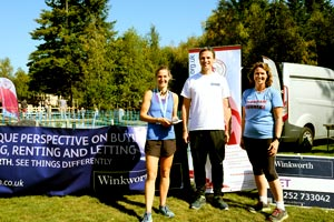 Ladies 10km winner presentation to Emily Trumpelmann with Stephen Tarrant and Jacquie Browne (FR Chairman)