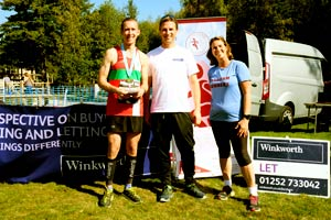 Male 10Km winner presentation to Christpher-Tizzardwith Stephen Tarrant and Jacquie Browne (FR Chairman)
