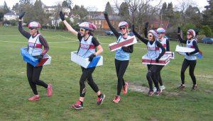 Farnham Runnings Bobsleigh team of six runners running in a line in fancy dress