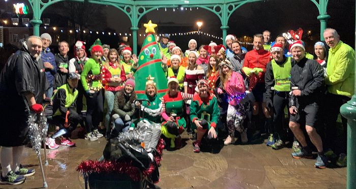 Group in Chrtistmas fancy at the bandstand in Farnham