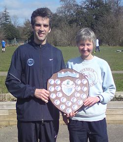 Dan Smith and Jane Georghiou with the 2009 Today's Runner Winter league shield