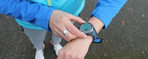 Runner setting sports watch