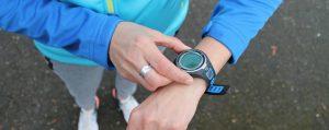 Runner setting sports watch