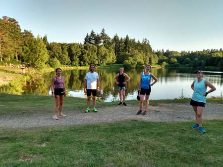 Runners by lake on Covid training run at Caesars Camp