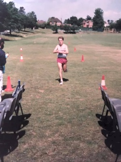 Richard Ferris crossing finish line to win the Club Championship