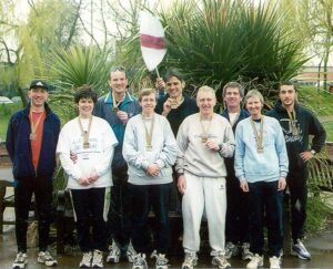 Group with medals after 2001 London Marathon