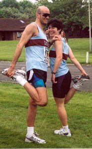Lindsay and Stoofer stretching at 2002 Alton 10