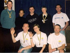 Group with medals after 2002 London Marathon