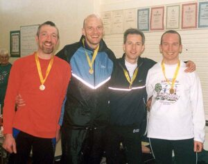 Group with medals after Neil Bellis race