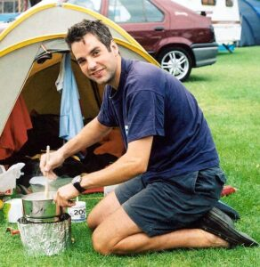 Dan Smith cooking meal at campsite for the 2002 Race the Train race in Wales