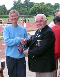 Jane Georghiou receiving medal at 2003 British Master Athletics Championships