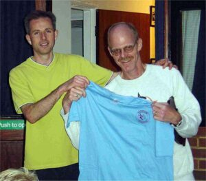 Member being presented with a T-shirt after the 2003 Club Championship