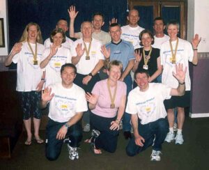 Group with medals at the club supper after the 2003 London Marathon