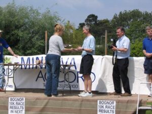 Jane Georghiou being presented with trophy at 2004 Bognor 10K