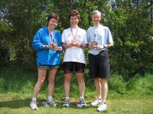 Farnham Runners ladies team with trophies at 2004 Bognor 10K