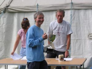 Farnham Runner Jane Georghiou being presented with the ladies trophy at the 2004 Butser Fell Race