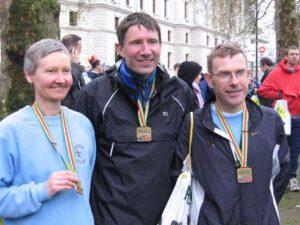 Three Farnham Runners with their medals at the 2004 London Marathon