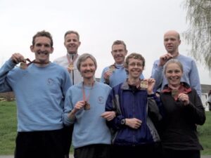 Group with medals after the 2006 London Marathon