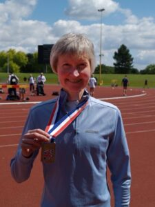 Jane Georghiou with medal at the 2007 British Master Athletics Championships