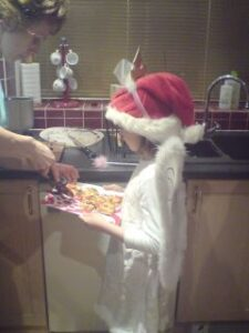 Child helping serving pizza slices at 2008 Mince Pie Run