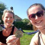 Vicky Goodluck and Helen Bracey with their Pilgrims half marathon medals