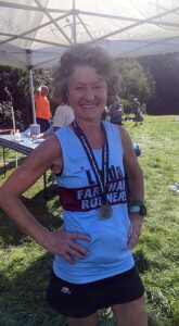 Linda Tyler with medal aftert the 2020 Pilgrims marathon