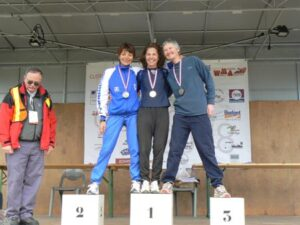 Jane Georghiou on the podium after the 2008 World Masters Athletics Championships cross country race