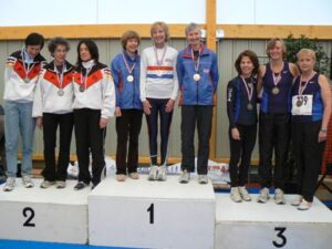 Jane Georghiou on the podium with winning ladies team after the 2008 World Masters Athletics Championships cross country race