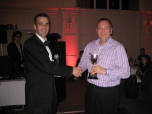 Richard Shepherd being presented with a trophy at the 2009 Annual Awards Dinner