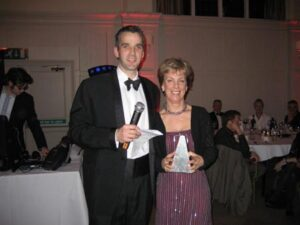 Shirley Perrett being presented with a trophy at the 2009 Annual Awards Dinner