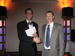 Bob Brimicombe receiving Grand Prix prize at the 2009 Annual Awards Dinner