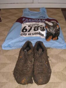 Muddy running shoes and vest after the 2009 National Cross Country Championships