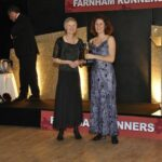 Jane Georghiou presenting Sarah Hill with the marthon trophy at 2012 Annual Awrads Dinner