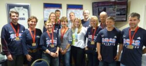 Group from 2012 London Marathon ata club supper with their medals