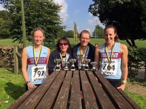Members with trophies at 2015 Alton Downland 10K