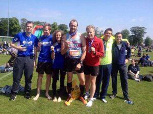 Group with medals after 2016 Edinburgh Marathon