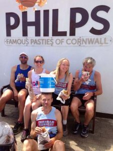 Group eating Cornish pasties during the John OGroats to Lands End 2016 FROGLE club relay