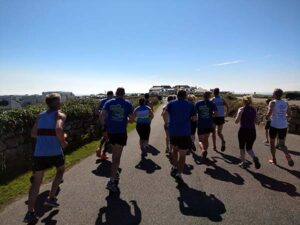 Group approaching Lands End in the the John OGroats to Lands End 2016 FROGLE club relay