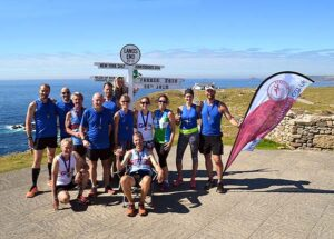 Group at Lands End after the run from John OGroats in the 2016 FROGLE club relay