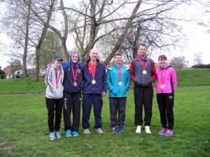 Group with medals after 2016 London Marathon